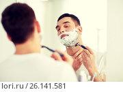 Купить «man shaving beard with razor blade at bathroom», фото № 26141581, снято 15 января 2016 г. (c) Syda Productions / Фотобанк Лори