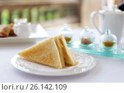 Купить «plate with toast bread on table», фото № 26142109, снято 21 февраля 2015 г. (c) Syda Productions / Фотобанк Лори