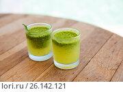 Купить «two glasses with drinks or cocktails on bar table», фото № 26142121, снято 15 февраля 2015 г. (c) Syda Productions / Фотобанк Лори
