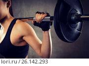 Купить «close up of woman with barbell in gym», фото № 26142293, снято 12 декабря 2015 г. (c) Syda Productions / Фотобанк Лори
