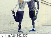 Купить «close up of couple stretching legs outdoors», фото № 26142337, снято 17 октября 2015 г. (c) Syda Productions / Фотобанк Лори