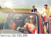 Купить «happy friends pushing broken cabriolet car», фото № 26143289, снято 28 мая 2016 г. (c) Syda Productions / Фотобанк Лори