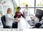 Купить «business team showing thumbs up at office», фото № 26143361, снято 1 октября 2016 г. (c) Syda Productions / Фотобанк Лори