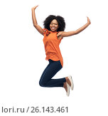 Купить «happy african american woman jumping over white», фото № 26143461, снято 18 марта 2017 г. (c) Syda Productions / Фотобанк Лори