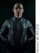Купить «Молодой мужчина в черной куртке», фото № 26161213, снято 30 марта 2017 г. (c) Юрий Викулин / Фотобанк Лори