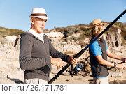 Купить «Senior man fishing with his grandson», фото № 26171781, снято 15 апреля 2015 г. (c) Sergey Nivens / Фотобанк Лори