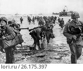 Купить «France: June 10, 1944 Allied soldiers wade ashore after disembarking from transport vessels along the French coast four days after D-Day.», фото № 26175397, снято 30 апреля 2017 г. (c) age Fotostock / Фотобанк Лори