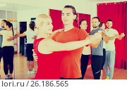 Купить «Expressive couple learning tango», фото № 26186565, снято 21 октября 2018 г. (c) Яков Филимонов / Фотобанк Лори