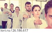 Купить «trainees expressing interest in attending karate class», фото № 26186617, снято 8 апреля 2017 г. (c) Яков Филимонов / Фотобанк Лори