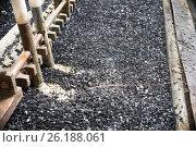 Купить «Industrial tinning of wire. Bath with molten solder», фото № 26188061, снято 3 апреля 2017 г. (c) Андрей Радченко / Фотобанк Лори