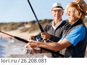 Купить «Senior man fishing with his grandson», фото № 26208081, снято 15 апреля 2015 г. (c) Sergey Nivens / Фотобанк Лори