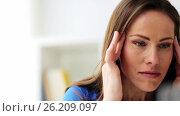 Купить «unhappy woman suffering from headache», видеоролик № 26209097, снято 20 июля 2018 г. (c) Syda Productions / Фотобанк Лори