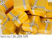 Close up of a pile of gold gifts on white, фото № 26209105, снято 18 августа 2012 г. (c) Tatjana Romanova / Фотобанк Лори