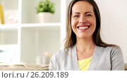 Купить «happy smiling middle aged woman at home», видеоролик № 26209189, снято 23 августа 2019 г. (c) Syda Productions / Фотобанк Лори