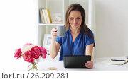 Купить «woman with tablet pc and coffee at home or office», видеоролик № 26209281, снято 26 апреля 2017 г. (c) Syda Productions / Фотобанк Лори