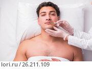 Купить «The handsome man in spa massage concept», фото № 26211109, снято 13 марта 2017 г. (c) Elnur / Фотобанк Лори