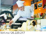 Купить «Man with cheese on counter», фото № 26220217, снято 5 октября 2016 г. (c) Яков Филимонов / Фотобанк Лори