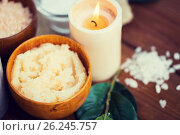 Купить «close up of natural body scrub and candle on wood», фото № 26245757, снято 21 декабря 2015 г. (c) Syda Productions / Фотобанк Лори