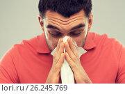 Купить «sick man blowing nose to paper napkin at home», фото № 26245769, снято 15 января 2016 г. (c) Syda Productions / Фотобанк Лори
