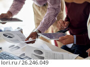 Купить «businessmen with tablet pc and charts at office», фото № 26246049, снято 1 октября 2016 г. (c) Syda Productions / Фотобанк Лори