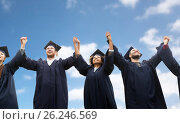 Купить «happy students or bachelors celebrating graduation», фото № 26246569, снято 24 сентября 2016 г. (c) Syda Productions / Фотобанк Лори
