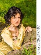 Купить «Молодая женщина на фоне весеннего пейзажа», фото № 26247197, снято 25 марта 2014 г. (c) Сергеев Валерий / Фотобанк Лори
