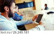 Купить «Executives using digital tablet in conference room», видеоролик № 26249181, снято 17 января 2020 г. (c) Wavebreak Media / Фотобанк Лори