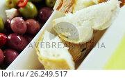 Купить «Olive tapas and pieces of bread», видеоролик № 26249517, снято 6 декабря 2019 г. (c) Wavebreak Media / Фотобанк Лори