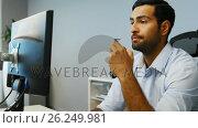 Купить «Male executive working on computer», видеоролик № 26249981, снято 17 января 2020 г. (c) Wavebreak Media / Фотобанк Лори