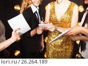 Купить «Superstar woman wearing golden shining dress crowded by paparazzi», фото № 26264189, снято 20 октября 2018 г. (c) Дарья Петренко / Фотобанк Лори