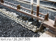 Купить «Industrial tinning of wire. Bath with molten solder», фото № 26267505, снято 3 апреля 2017 г. (c) Андрей Радченко / Фотобанк Лори