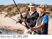 Купить «Senior man fishing with his grandson», фото № 26285289, снято 15 апреля 2015 г. (c) Sergey Nivens / Фотобанк Лори