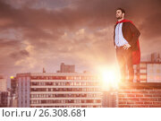 Купить «Composite image of businessman pretending to be super hero with hands on hip», фото № 26308681, снято 24 мая 2018 г. (c) Wavebreak Media / Фотобанк Лори