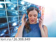 Купить «Composite image of young woman listening to music on headphones with closed eyes», фото № 26308849, снято 26 июня 2019 г. (c) Wavebreak Media / Фотобанк Лори