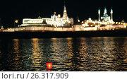 Купить «Kazan, Russia, 12 may 2017 - Kazan kremlin with reflection in river at night with red floating lantern», видеоролик № 26317909, снято 23 июля 2018 г. (c) Константин Шишкин / Фотобанк Лори