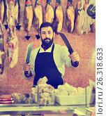 Купить «Man seller preparing meat to sell in butcher's shop», фото № 26318633, снято 16 ноября 2016 г. (c) Яков Филимонов / Фотобанк Лори
