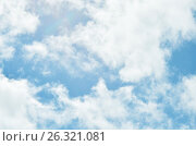 Blue sky with puffy white clouds in bright sunny day. Стоковое фото, фотограф Irina Shisterova / Фотобанк Лори