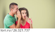 Купить «Man whispering in woman's ear over colored background», фото № 26321737, снято 23 июля 2019 г. (c) Wavebreak Media / Фотобанк Лори