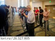 Купить «Muslim men gather for Friday afternoon prayers during religious services at an Anaheim, CA, mosque. Clasped hand position indicates Sunni Muslim persuasion.», фото № 26327805, снято 14 октября 2016 г. (c) age Fotostock / Фотобанк Лори