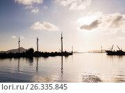 Купить «turbines at wind farm on sea shore», фото № 26335845, снято 8 февраля 2017 г. (c) Syda Productions / Фотобанк Лори