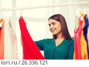happy woman choosing clothes at home wardrobe. Стоковое фото, фотограф Syda Productions / Фотобанк Лори