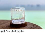 Купить «glass with cold water or cocktail on bar table», фото № 26336269, снято 15 февраля 2015 г. (c) Syda Productions / Фотобанк Лори