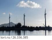 Купить «turbines at wind farm on sea shore», фото № 26336385, снято 8 февраля 2017 г. (c) Syda Productions / Фотобанк Лори