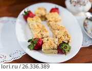 Купить «pieces of cake or pie and strawberries on plate», фото № 26336389, снято 21 февраля 2017 г. (c) Syda Productions / Фотобанк Лори