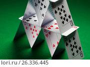 Купить «close up of house of playing cards on green cloth», фото № 26336445, снято 15 марта 2017 г. (c) Syda Productions / Фотобанк Лори