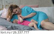 Affectionate mother breastfeeding her baby girl. Стоковое видео, видеограф Швец Анастасия / Фотобанк Лори