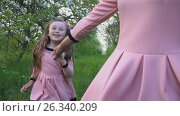 Купить «Mom and daughter are running», видеоролик № 26340209, снято 8 мая 2017 г. (c) Kozub Vasyl / Фотобанк Лори