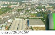 Купить «Aerial view from descending airplane», видеоролик № 26340561, снято 11 мая 2017 г. (c) Игорь Жоров / Фотобанк Лори