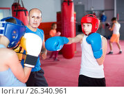Купить «Boxing instructor closely follows the teenagers in sparring», фото № 26340961, снято 12 апреля 2017 г. (c) Яков Филимонов / Фотобанк Лори