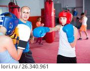Купить «Boxing instructor closely follows the teenagers in sparring», фото № 26340961, снято 12 апреля 2017 г. (c) Яков Филимонов / Фотобанк Лори